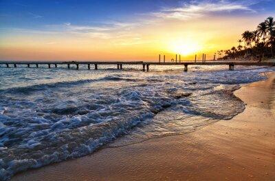 Fototapete Karibisches Meer Strand Sonnenuntergang mit Palmen.