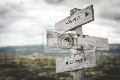 Fototapete Keep it simple signpost. Nature, adventure, message, text, quote concept.