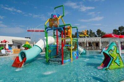 Fototapete KUSADASI, TURKEY - AUGUST 21, 2017: Colourful plastic slides in aquapark. Children water playground.