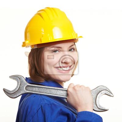 Lachende Bauarbeiterin Mit Schraubenschlussel Fototapete