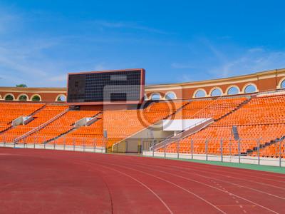 Fototapete Leere Anzeigetafel und Rennstrecke im Stadion