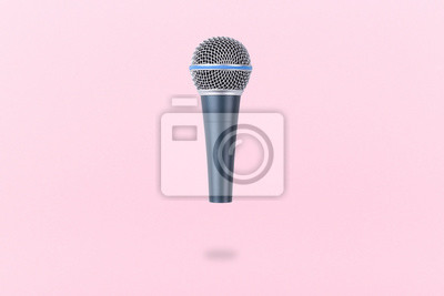 Fototapete levitating microphone on a pink background, the image in the air