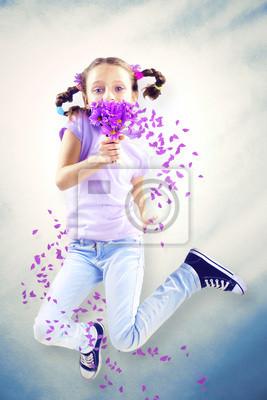 Little girl smelling flower in spring