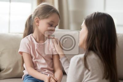 Fototapete Loving mom talking to upset little child girl giving support