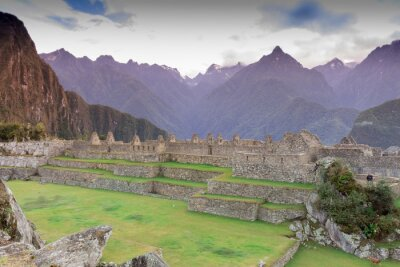 Fototapete Machu Picchu, Cusco, Peru in the early morning mist, found on the steep slopes of the Andes Mountains.