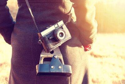 Fototapete Mädchen mit Retro-Vintage-Kamera.