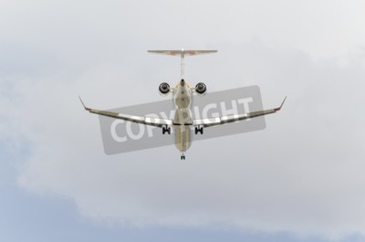 Fototapete MADRID, SPAIN - FEBRUARY 14th 2015: Aircraft -Bombardier CRJ-900-, of -Iberia- airline, is landing on Madrid-Barajas -Adolfo Suarez- airport, on February 14th 2015.