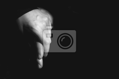 Fototapete male and female hand together on a black background
