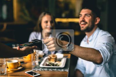 Fototapete man paying bill at fancy restaurant