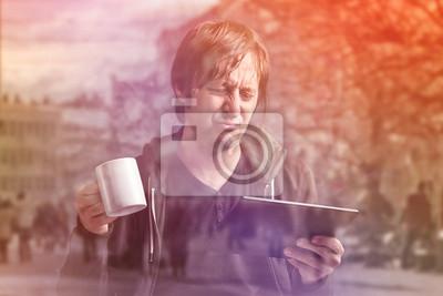 Fototapete Man Reading Bad News on Digital Tablet Computer