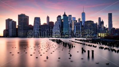 Fototapete Manhattan skyilne, New York City at sunset.