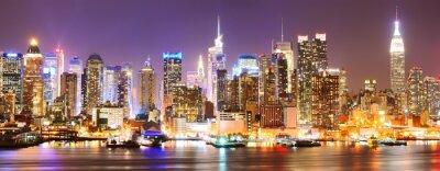 Fototapete Manhattan Skyline bei Nacht.