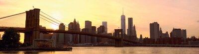 Fototapete Manhattan Skyline Panorama mit Brooklyn Bridge bei Sonnenuntergang, New York, Vereinigte Staaten