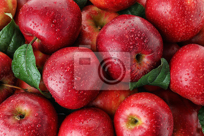Fototapete Many ripe juicy red apples covered with water drops as background