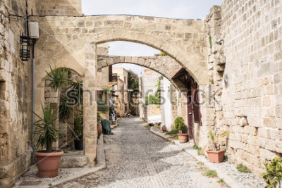 Fototapete Medieval arched street in the old town of Rhodes, Greece