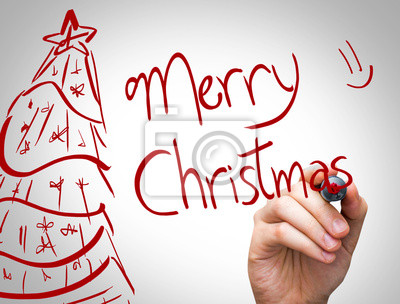 """""""Merry Christmas"""" Hand writing with red marker"""