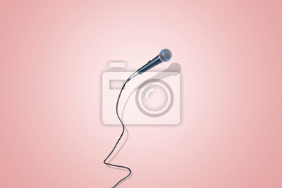 Fototapete microphone levitating in the air, image over pink background, the concept of accessories for singing
