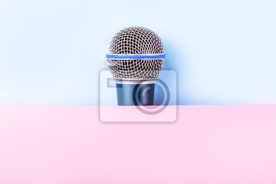 Fototapete microphone on a pink-blue background, stage accessory
