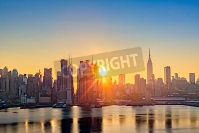 Fototapete Midtown Manhattan Skyline bei Sonnenaufgang, wie von Weehawken, entlang der 42. Straße Canyon
