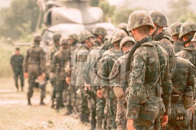 Fototapete Military boots, military uniforms of the international military standing.Prepare for firearm training.
