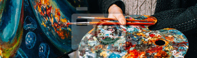 Fototapete Modern fine art school. Female painter holding colorful palette and paintbrushes over abstract artwork.