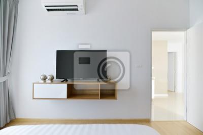 Fototapete Modernes Leeres Schlafzimmer Mit Led Tv Auf Weisser Wand Und Holzregal