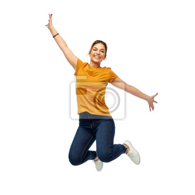 Fototapete motion, freedom and people concept - happy young woman or teenage girl jumping over white background