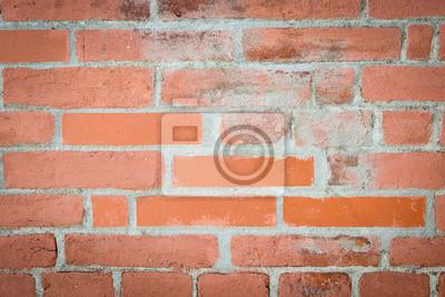 Mur de briques rouges abimé