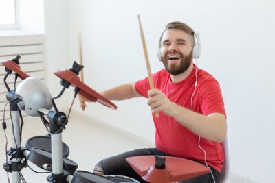 Fototapete Music, people and hobby concept - man drummer playing the drum and looks like very emotional