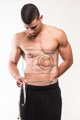 Muskuläre Fitness Mann Messung seiner Taille
