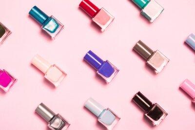 Fototapete Nail polish bottles pattern background. Close up.