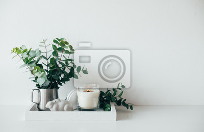 Fototapete Natural eco home decor with green leaves and burning candle on t