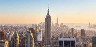 Fototapete New York City Skyline von Manhattan im Sonnenuntergang.