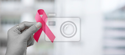 Fototapete October Breast Cancer Awareness month, Woman holding Pink Ribbon for supporting people living and illness. Healthcare, International women day and World cancer day concept