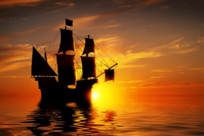 Fototapete Old ancient pirate ship on peaceful ocean at sunset.