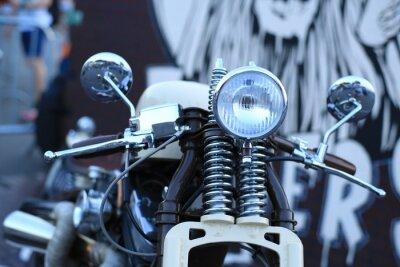 Fototapete Old vintage Motorrad mit Chrom-Akzenten und einem Scheinwerfer