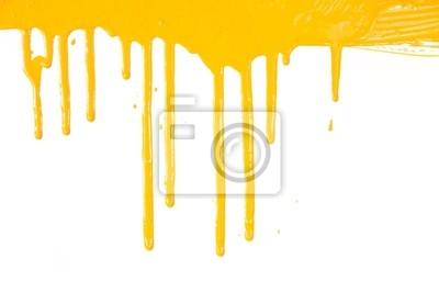 Orange Farbe tropft / isoliert auf weiß / real photo