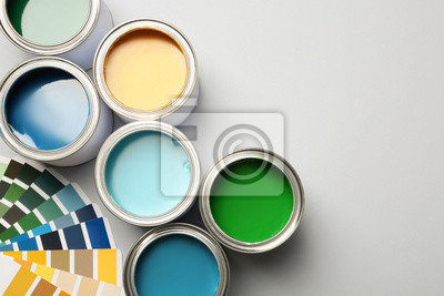 Fototapete Paint cans and color palette on white background, top view. Space for text