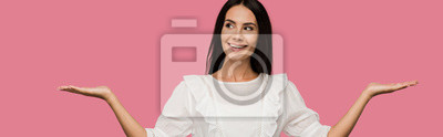 Fototapete panoramic shot of cheerful woman in white dress gesturing isolated on pink