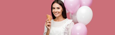 Fototapete panoramic shot of woman holding balloons and ice cream cone isolated on pink