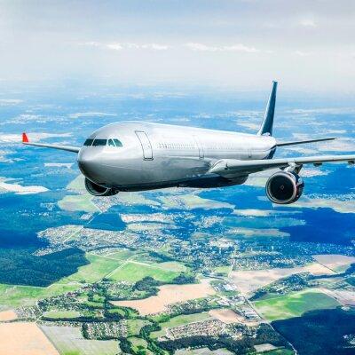 Fototapete Passagierflugzeug in den Himmel