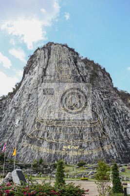 PATTAYA - THAILAND 2015: Khao Chee Chan - Buddha laser carved and inlayed with gold on the cliff.