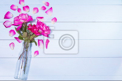 Pink Roses In A Vase On A Blue Wooden Background Fototapete