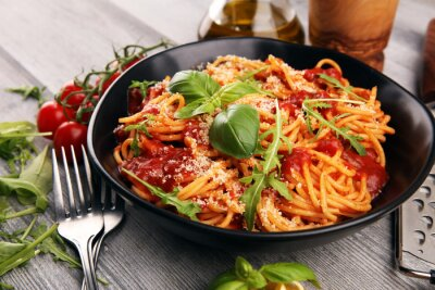 Fototapete Plate of delicious spaghetti Bolognaise or Bolognese with savory minced beef and tomato sauce garnished with parmesan
