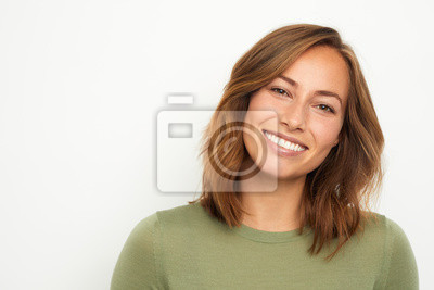 Fototapete portrait of a young happy woman smiling on white background