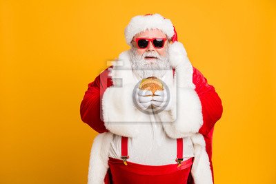 Fototapete Portrait of funny funky fat santa claus dont care about health eat fast food big sandwich on x-mas tradition celebration wear style stylish suspenders isolated over shine color background