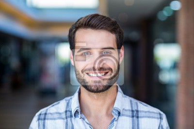 Fototapete Portrait of happy smiling man