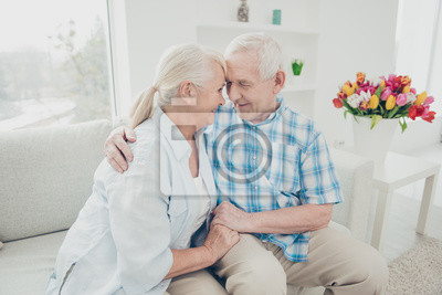 Fototapete Portrait of her she his he two nice attractive adorable lovely kind sweet gentle cheerful cheery peaceful calm spouses cuddling holding hands in light white interior living-room indoors