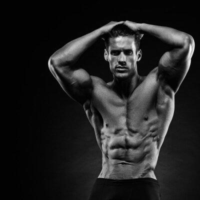 Fototapete Porträt einer schönen muskulösen Bodybuilder posieren