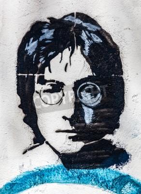 Fototapete PRAG, TSCHECHISCHE REPUBLIK - APRIL 29, 2016: John Lennon Wall, Porträt. Die Mauer wurde mit Lennon inspirierten Graffiti und Texten von Beatles Songs seit 1980er Jahren als Reiz des Kommunismus gefül